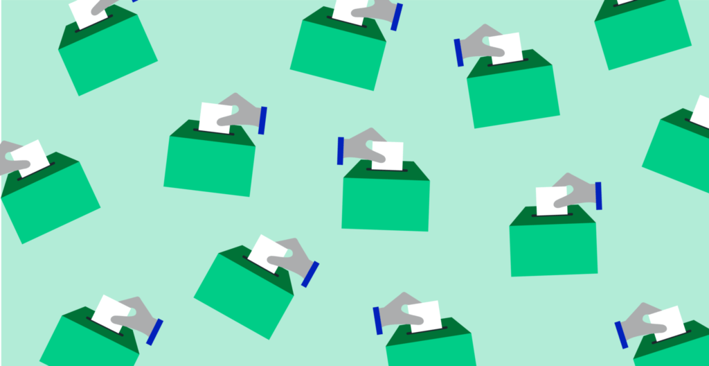Hands voting in ballot boxes