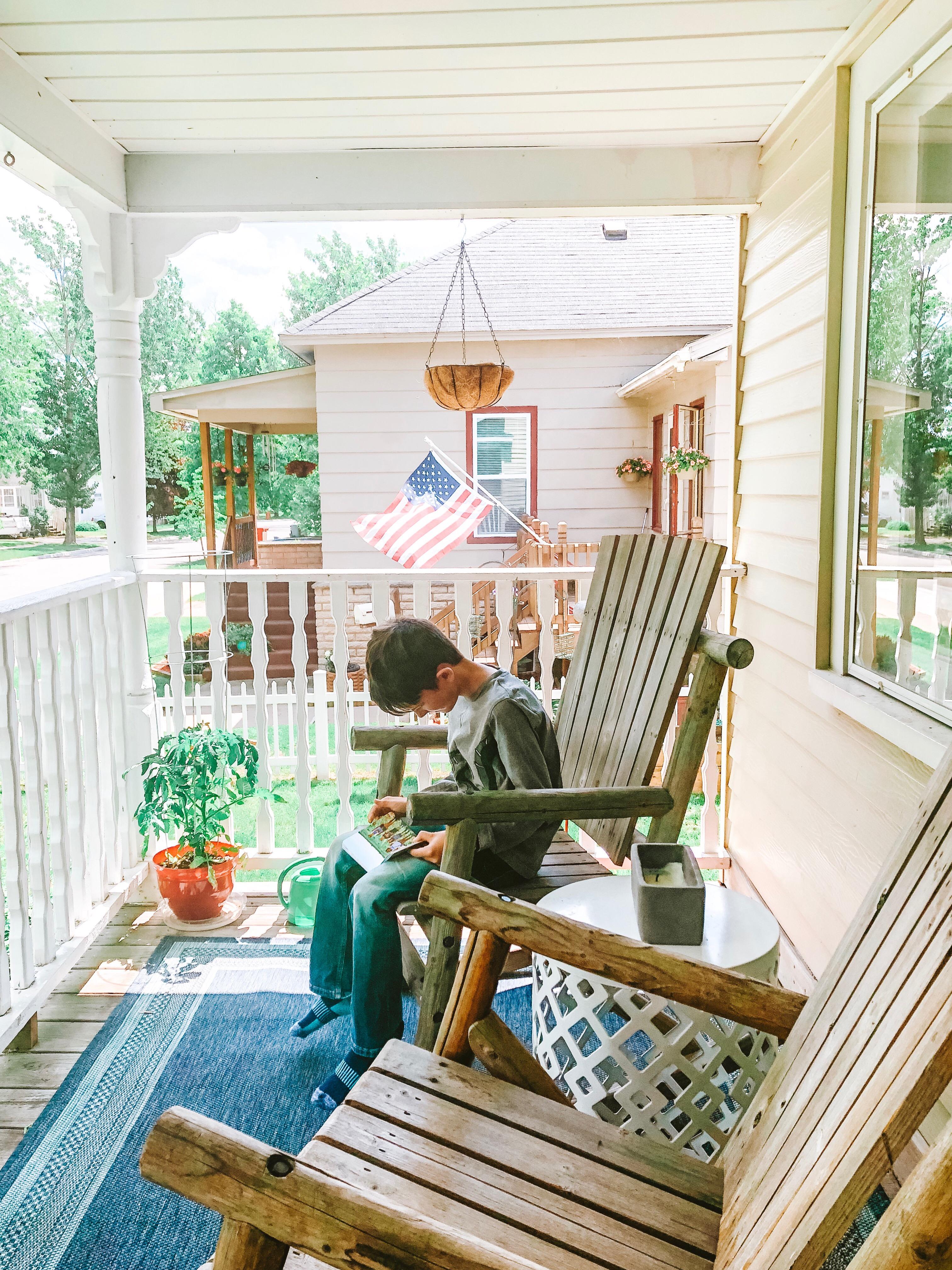 boy-reading-on-porch