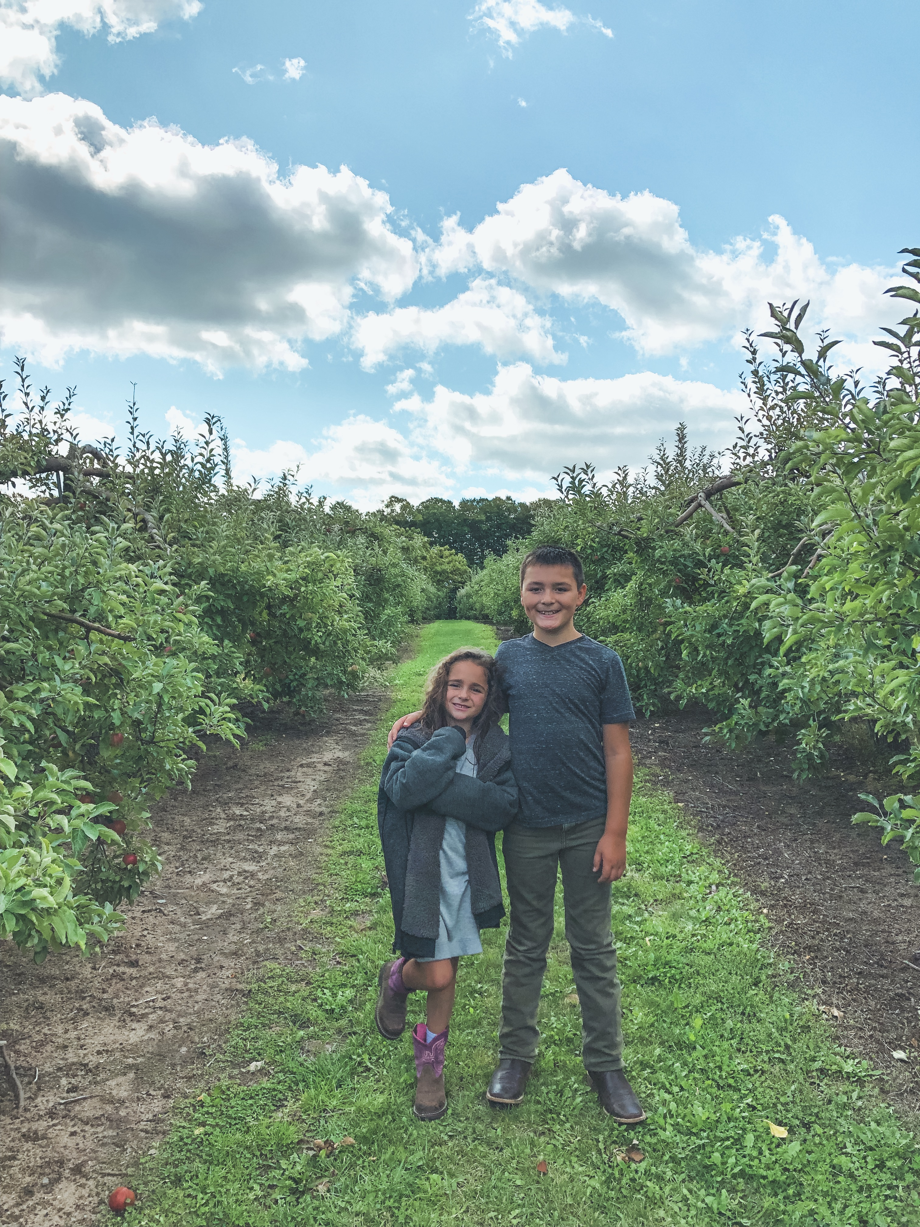 kids-standing-in-apple-orchard