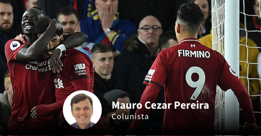 O trio Mané, Salah e Firmino. Paul ELLIS / AFP