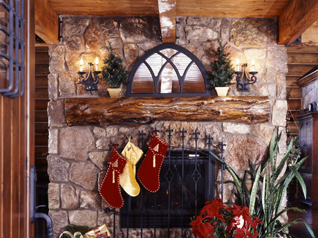 Stockings adorn the stone fireplace