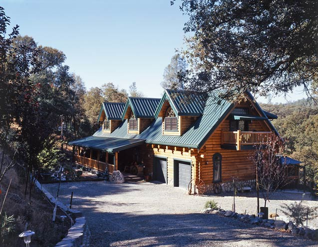 Photos of a creekside log home heritage log homes for Log cabin styles