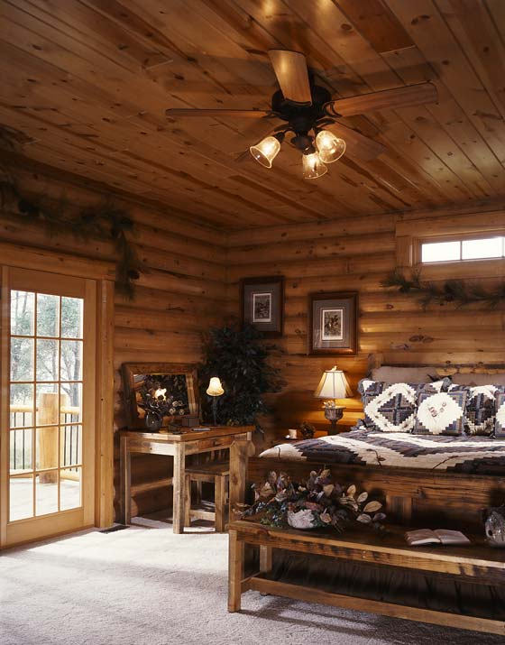 In The Master Bedroom, Slightly Distressed Wood Furniture Complements The  Warm Carmel Tone Of The Logs.