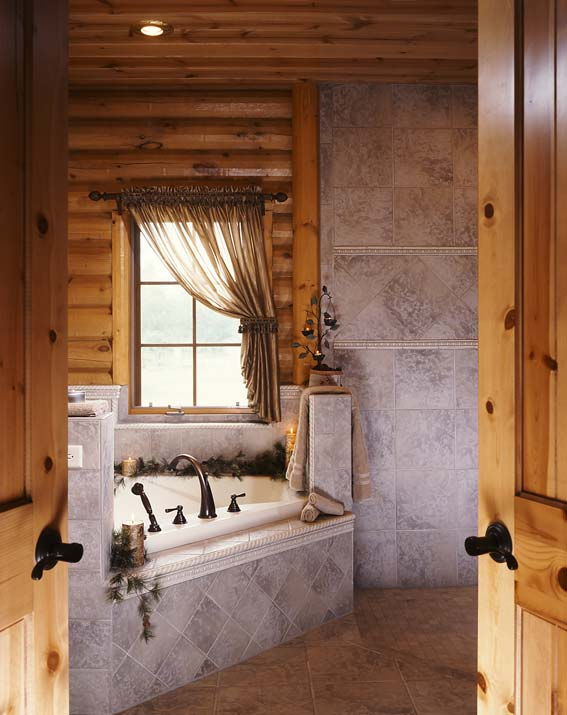 Photos of a modern log cabin golden eagle log homes for Cabin shower tile ideas