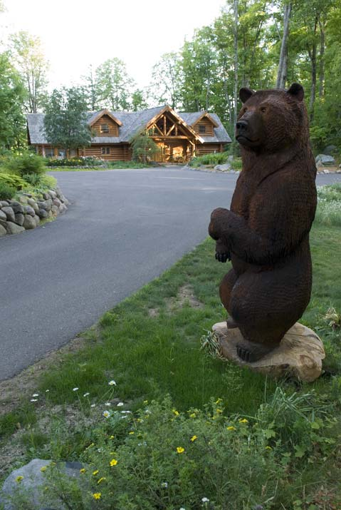 Carved Wooden Bear Outside Cabin