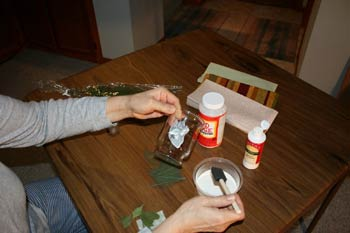 applying flowers to your candle holder