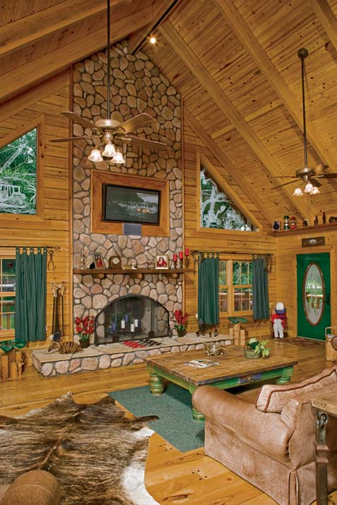 Photos of a custom log home in rural florida for Log home fireplace pictures