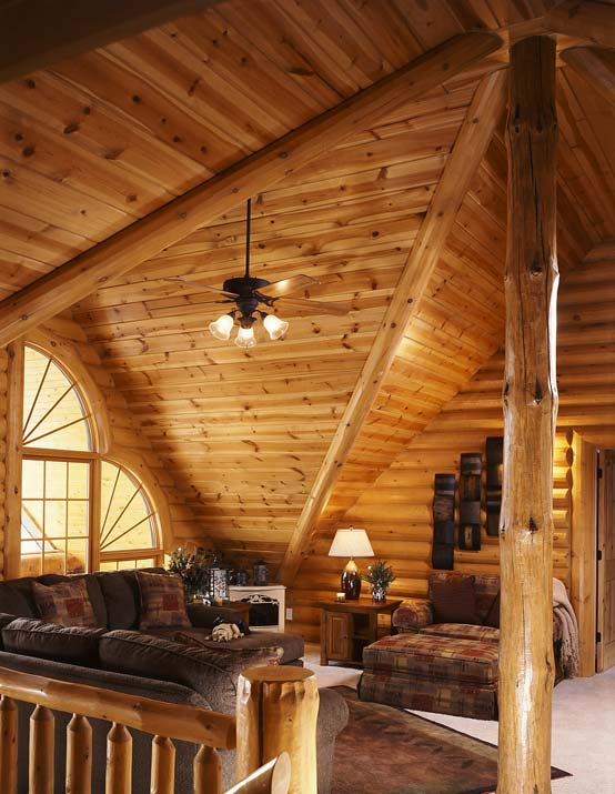 Photos of a modern log cabin golden eagle log homes for Log cabin with loft