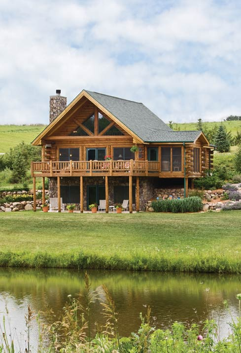 rustic expedition log home by creek in field