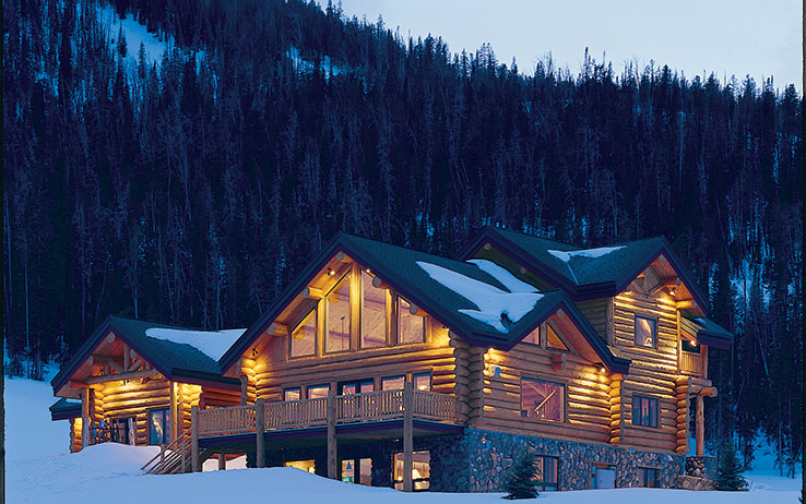 12 snow covered log cabins