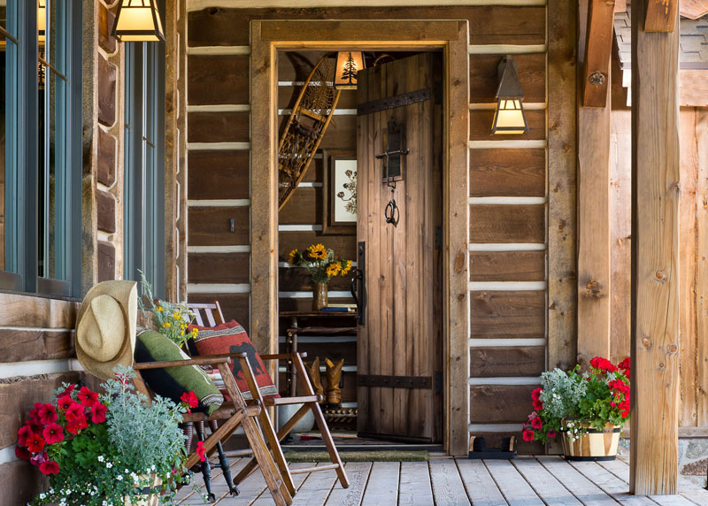Dark Stained Log Home Front Porch