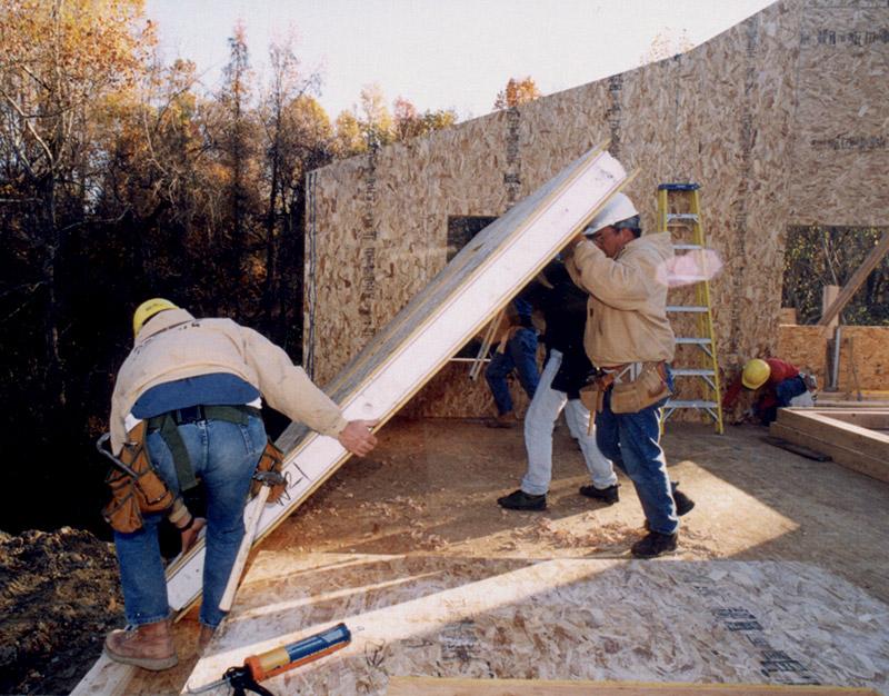 installing SIP panels timber frame home