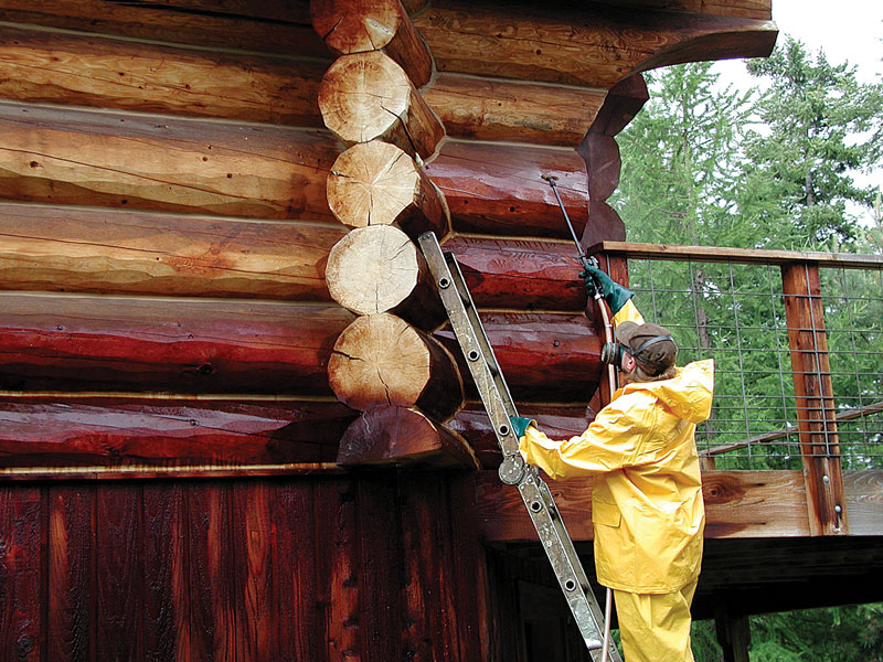 Staining  Log Home With Sprayer
