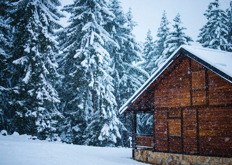 Snow-Covered Cabin in Winter