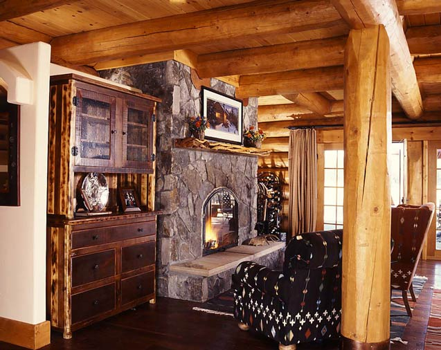 Off the beaten path planning a secluded log cabin for Log home fireplaces