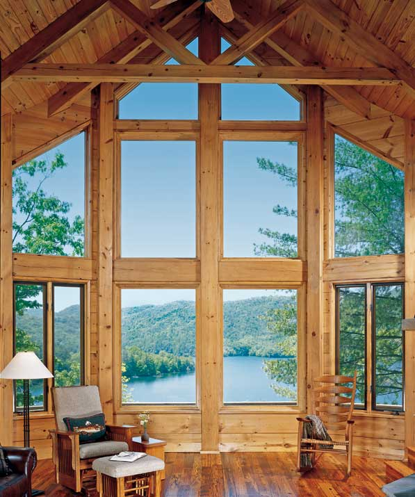 Nature 39 s goodness planning an earth friendly log home for Log cabin window