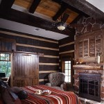 High ceilings and windows in one of the four bedrooms offset the dark wood. Earth-toned Western decor complements the building materials.