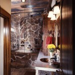 The master bathroom achieves its rough-hewn charm by blending faux stone for the tub surround, flat-plate steel with a hammered edge for countertops and wood paneling.