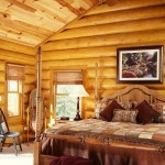 The warmth of the cedar stained logs helps create an inviting bedroom sanctuary. The bedroom suite is from Broyhill's Yorkshire Market line. The green, gold and rose patchwork squares of the bedspread from J. C. Penney's offer a rich contrast to the master bedroom's pale green walls.