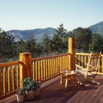 The log posts on the 10-by-36-foot deck cost more than plain wood posts, but the couple preferred the look. The decking is pine. The deck rocker is from Lowe's.