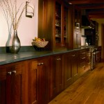 Cabinets made from reclaimed wood line the back wall of the dining area and kitchen. A wine cellar is tucked behind this wall.
