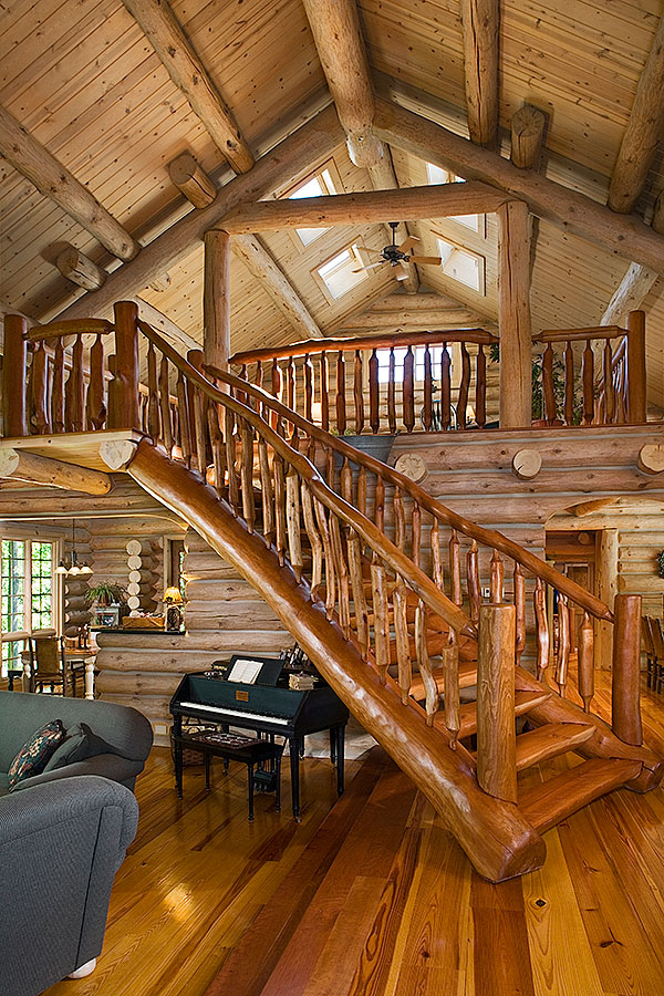 A michigan rustic log home with a ski lodge feel Inside staircase in houses