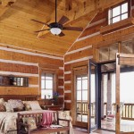 The master bedroom enjoys a tall ceiling punctuated by timber trusses, and is enclosed by warm wood but with plenty of glass to enjoy the view. French doors lead to a porch that looks down at the city of Golden.