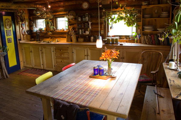 """Ample space in the kitchen was a must-have for the couple. """"We do a number of homestead activities, like canning and making beer, wine, and sausage,"""" Linda says. Extra supplies are stored in the home's basement."""