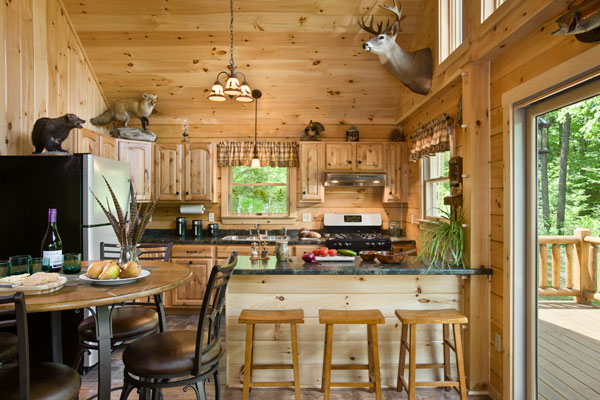 """Lisa's favorite part of the cabin, the modest but fully functional kitchen, is just the right size for the family — and for cooking and serving the many animals John and Spencer bag. """"We harvest everything we hunt,"""" says John. """"Nothing goes to waste."""""""