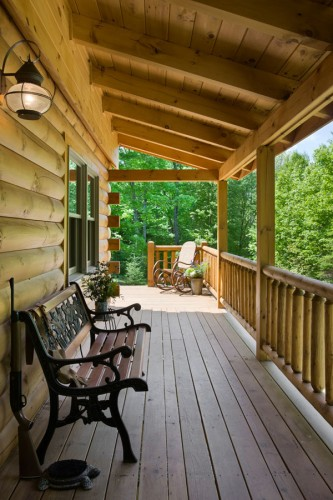 The comfortable side deck, with its sprawling views of the surrounding forest, provides the perfect spot for John and his son, Spencer, to plan their next hunting or trout-fishing expedition. Eventually, Lisa hopes to add a screened-in porch to the cabin to protect against pests.