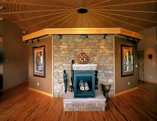 "Faux stone surrounds the three-sided fireplace, behind which sits homeowner K.T. Miller's favorite space in the house: the media room. ""It has a 65-inch screen with a very big sound system,"" he says. ""I don't go to the theater anymore."""