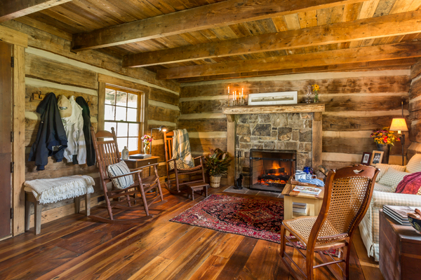 As part of the restoration, mud filling the gaps between the hand-hewn logs was scraped out and replaced with period-appropriate mortared chinking. The living room's handsome stone fireplace, which looks as aged as the chestnut timber surrounding it, is actually brand new.