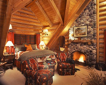 roaring-fire-in-log-home-bedroom1