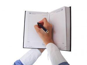 1182878_woman_writing_in_the_agenda1