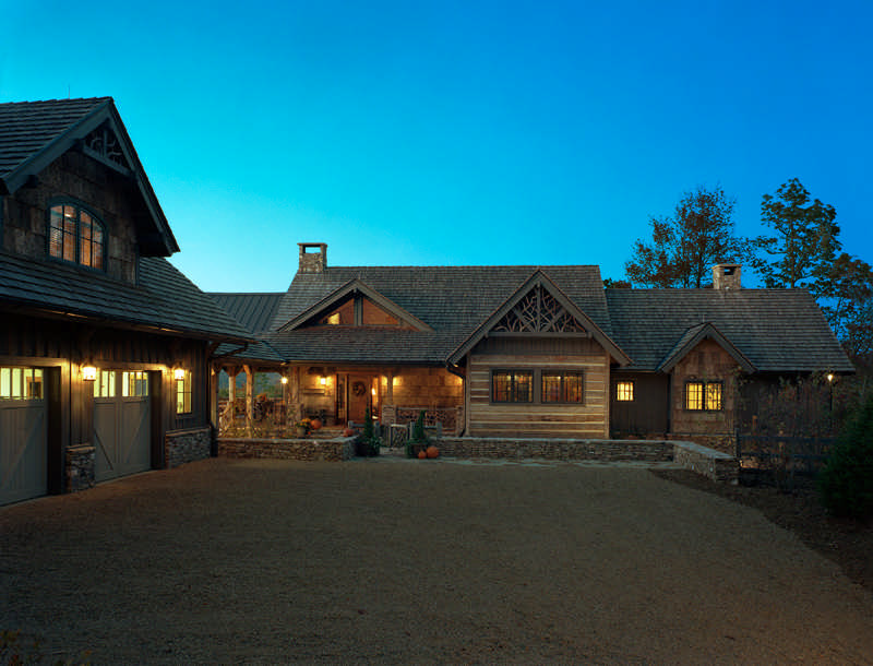 The home's exterior is covered in an Appalachian Antique Hardwoods product called Corduroy Pine, which was pre-finished and stained green. The chinked logs are actually a wood veneer, which gives the home the energy benefits of traditional insulation.