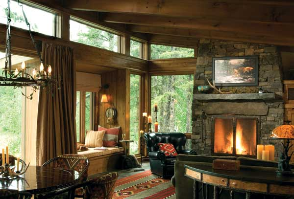 A cozy alternative to the soaring great room hearth, this one-story fireplace is the perfect size for this casual Montana getaway. Photo by Heidi Long.