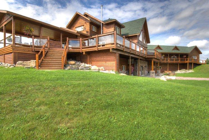 Pine ridge luxury log home plan by 1867 confederation for Luxury log home floor plans