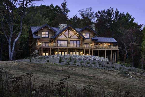 """We were very set on getting a handcrafted log home,"" says Caroline Hickerson of her and husband David's decision to build a weekend retreat on 45 acres near Virginia's Shenandoah National Park. ""We liked the fact that the logs aren't uniform and that they're hand-peeled, and we liked the massiveness of the house. It's just so interesting architecturally."""