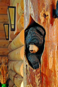 arts and crafts log home bear carving