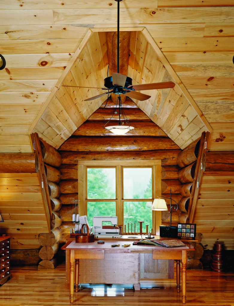 log home office sloped ceiling window desk