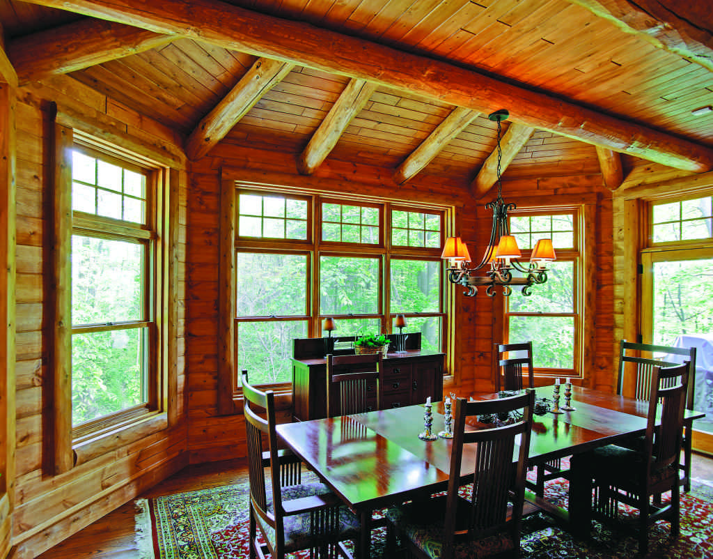 Michigan lakeside log home eating area with windows