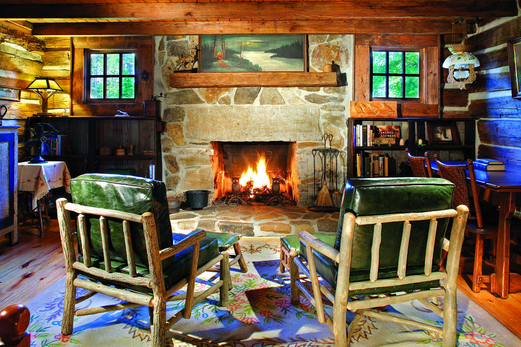 log cabin living room stone fireplace