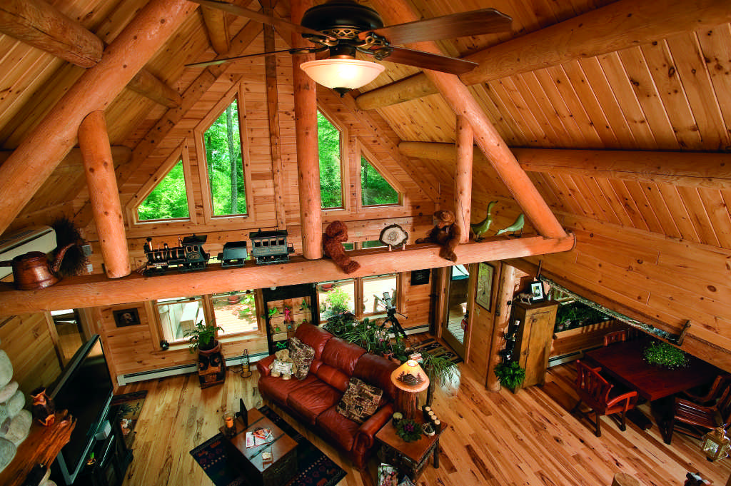 Maine log home interior great room log beams