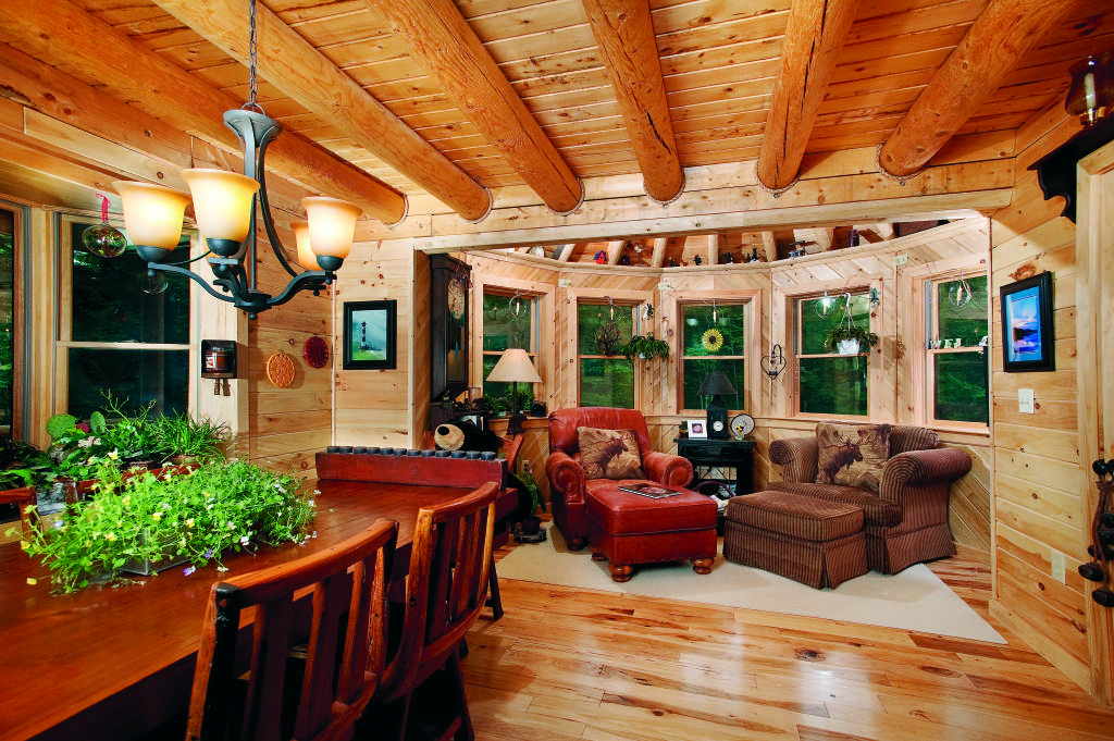Maine log home interior dining room reading nook