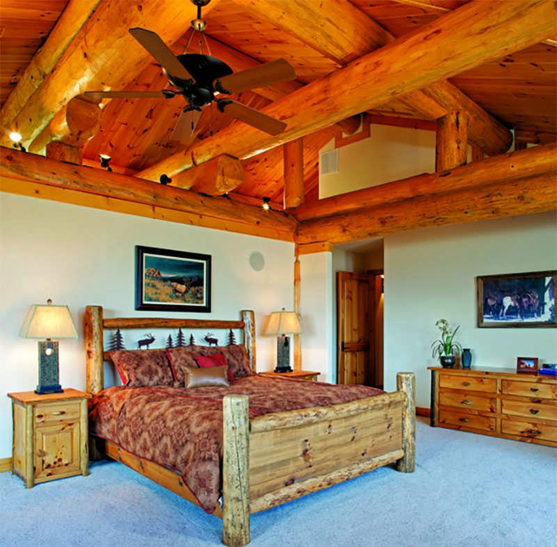 Colorado log home bedroom log beams