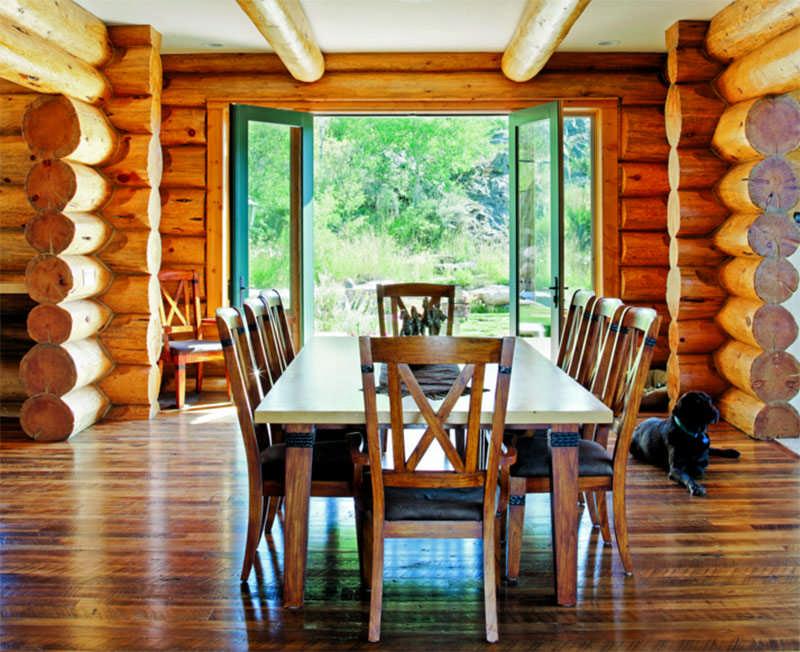 Colorado log home dining room open door log walls