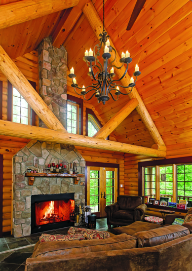 New York log home great room chandelier stone fireplace