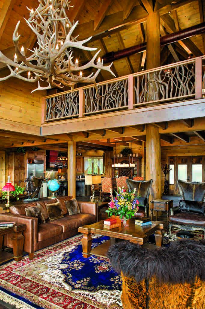 log home great room leather furniture antler chandelier