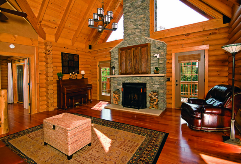 log home great room stone fireplace