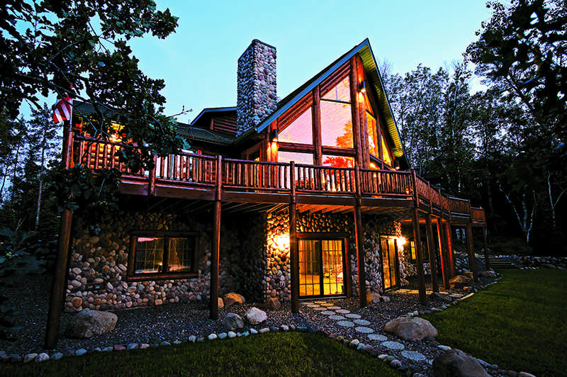 half-log house with simulated river rock